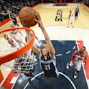 WASHINGTON, DC - MARCH 3: Tayshaun Prince #21 of the Memphis Grizzlies dunks against the Washington Wizards during the game at the Verizon Center on March 3, 2014 in Washington, DC. (Photo by Ned Dishman/NBAE via Getty Images)