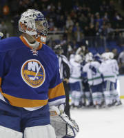 New York Islanders goalie Evgeni Nabokov (20) leaves the ice after the overtime period of an NHL hockey game against the Vancouver Canucks Tuesday, Oct. 22, 2013 in Uniondale, N.Y. The Canucks won the game 5-4. (AP Photo/Frank Franklin II)