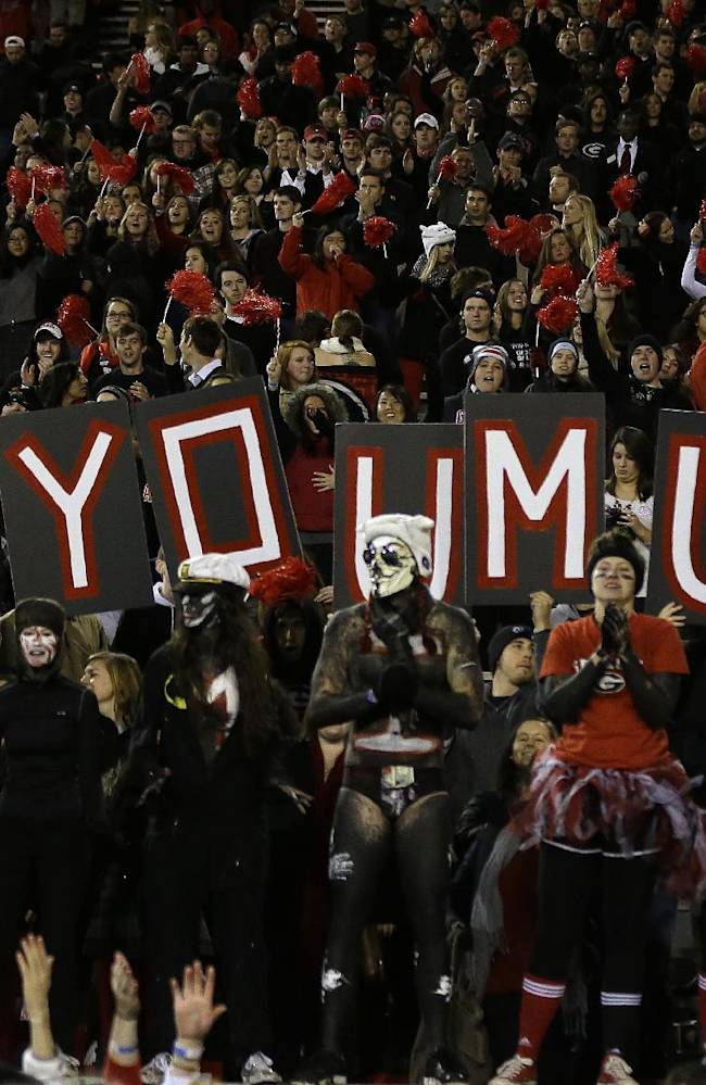 Georgia fans show their support for senior quarterback Aaron Murray after Georgia defeated Kentucky 59-17 in an NCAA college football game on Saturday, Nov. 23, 2013, in Athens., Ga.  Murray threw four touchdowns before being injured and leaving the game in the second half