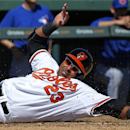 Baltimore Orioles' Nelson Cruz (23) scores on a double by Chris Davis during the third inning of an exhibition spring training baseball game in Sarasota, Fla., Saturday, March 1, 2014 The Associated Press