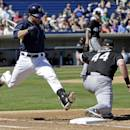 Milwaukee Brewers' Jonathan Lucroy is out at first with Chicago White Sox's Adam Dunn (44) covering on a ground ball during the first inning of an exhibition spring training baseball game Monday, March 10, 2014, in Phoenix. (AP Photo/Morry Gash)