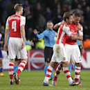 Arsenal's Nacho Monreal, centre hugs his teammate Arsenal's Kieran Gibbs after the end of the Group D Champions League match between Anderlecht and Arsenal at Constant Vanden Stock Stadium in Brussels, Belgium, Wednesday Oct. 22, 2014. Gibbs scored his si