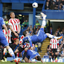 Chelsea's Fernando Torres shoots the ball during their English Premier League soccer match against Sundrerland at the Stamford Bridge ground in London, Saturday, April 19, 2014. Sunderland won the match 2-1