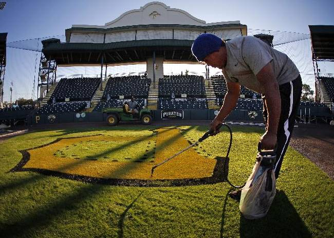 Head grounds keeper Victor Madrigal paints a Pirates logo on the field at the spring training home of the Pittsburgh Pirates, McKechnie Field, in Bradenton, Fla., Monday, Feb. 10, 2014. Pirates pitchers and catchers begin workouts on Thursday, Feb. 13