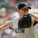 Boston Red Sox starting pitcher John Lackey throws against the Minnesota Twins during the inning inning of a baseball game on Sunday, May 19, 2013, in Minneapolis. (AP Photo/Genevieve Ross)