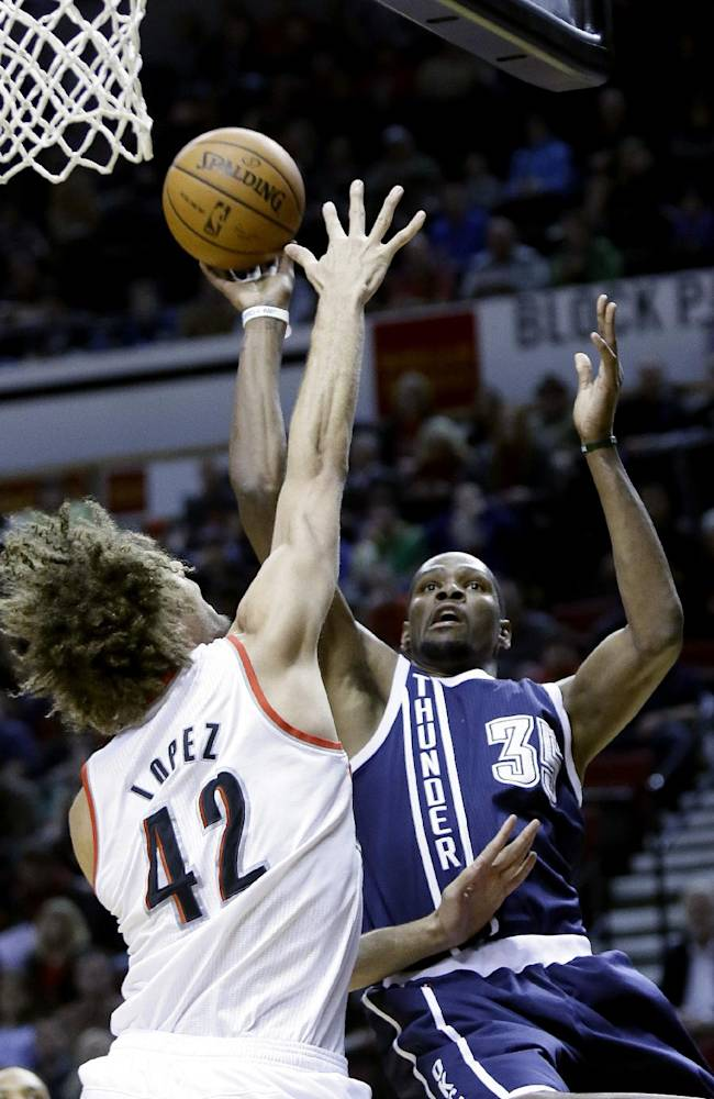 Oklahoma City Thunder forward Kevin Durant, right, shoots over Portland Trail Blazers center Robin Lopez during the first half of an NBA basketball game in Portland, Ore., Tuesday, Feb. 11, 2014