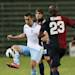 Lazio's Miroslav Klose, left, and Cagliari's Victor Ibarbo fight for the ball during their Serie A soccer match between Cagliari and Lazio, at the Nereo Rocco Stadium in Trieste, Italy, Sunday, May 19, 2013