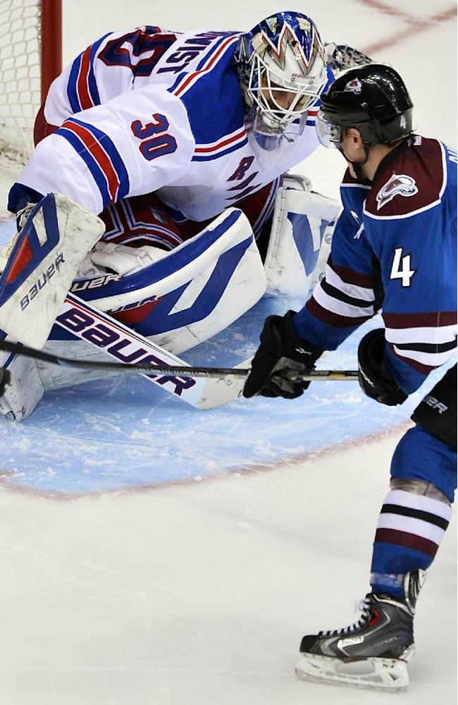 Colorado Avalanche defenseman Tyson Barrie (4) slips the puck past New York Rangers goalie Henrik Lundqvist (30), of Sweden, for the game-winning shootout goal during an NHL hockey game on Thursday, April 3, 2014, in Denver. Colorado won 3-2