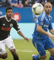 Montreal Impact's Marco Di Vaio is dogged by Philadelphia Union's Sheanon Williams during the first half a MLS soccer game in Montreal Saturday, Oct. 19, 2013. (AP Photo/The Canadian Press, Peter McCabe)