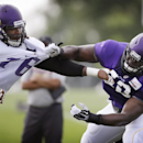 Minnesota Vikings guard Vladimir Ducasse, right, blocks defensive tackle Isame Faciane during an NFL football training camp practice, Wednesday, July 30, 2014, in Mankato, Minn The Associated Press