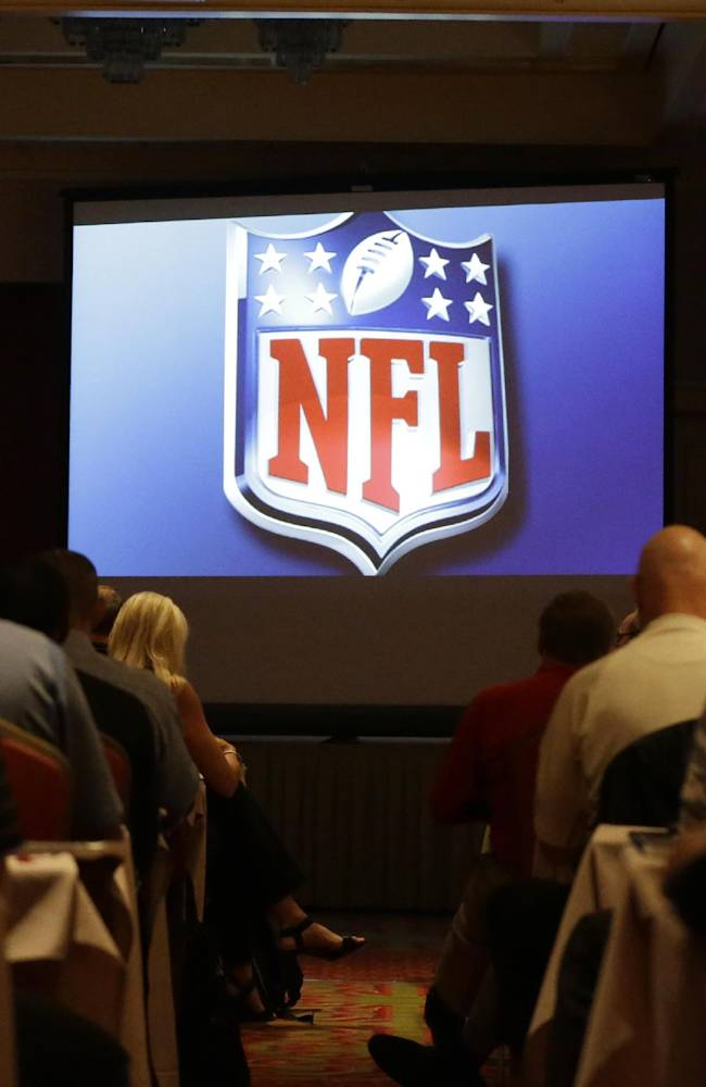 Football game officials begin to watch a video during the NFL Officiating Clinic in Irving, Texas, Friday, July 18, 2014.  The NFL's 119 game officials are attending the league's officiating developmental program held at a hotel in North Texas