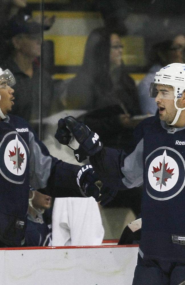 Winnipeg Jets' Evander Kane (left) and Devin Setoguchi celebrate a goal during a scrimmage at NHL hockey training camp Thursday, Sept. 12, 2013, in Winnipeg, Manitoba