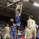 Duke's Mason Plumlee (5) dunks the ball against the Boston College defense during the first half of an NCAA college basketball game in Boston, Sunday, Feb. 10, 2013. (AP Photo/Mary Schwalm)
