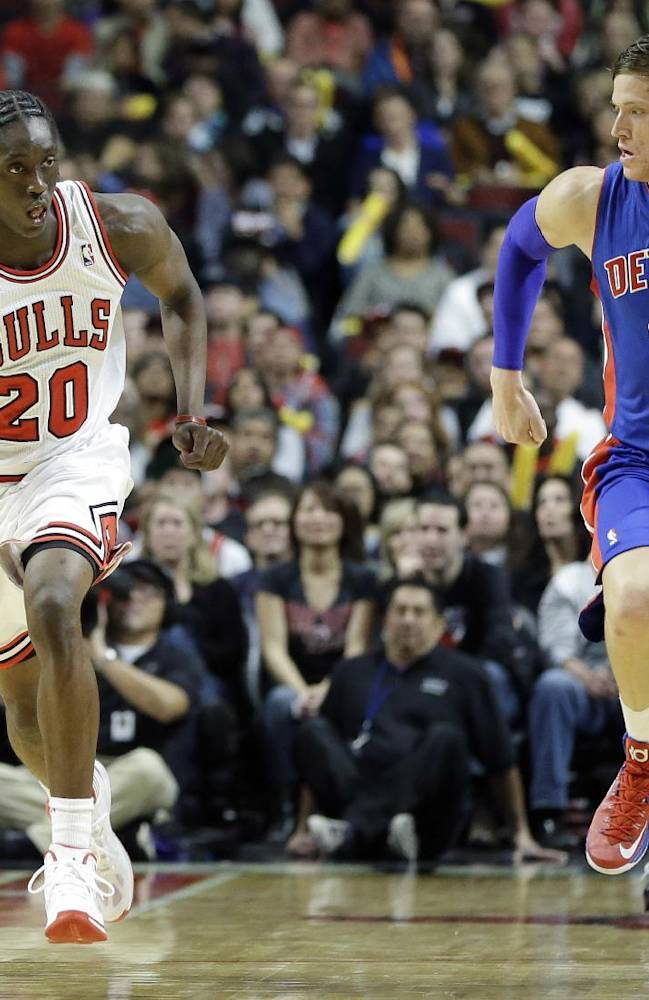 Chicago Bulls forward Tony Snell (20) controls the ball against Detroit Pistons forward Jonas Jerebko during the second half of an NBA preseason basketball game in Chicago on Wednesday, Oct. 16, 2013. The Bulls won 96-81