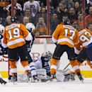 Winnipeg Jets' Ondrej Pavelec, center, stops the shot by Philadelphia Flyers' Jakub Voracek, of Czech Republic, second from the left, with Winnipeg Jets' Mark Stuart, left, Dustin Byfuglien, third from the left, and James Wright, right, along with Philade