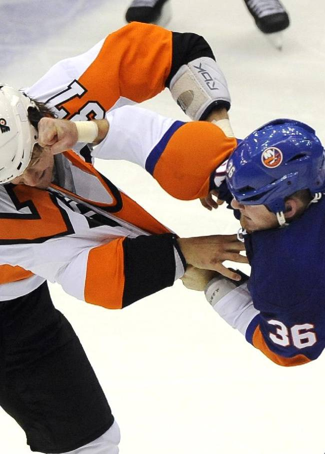 New York Islanders' Eric Boulton (36) punches Philadelphia Flyers' Jay Rosehill (37) during a fight in the first period of an NHL hockey game at the Nassau Coliseum on Saturday, Oct. 26, 2013, in Uniondale, N.Y. The Flyers won 5-2