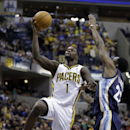 Indiana Pacers guard Lance Stephenson, left, shoots in front of Memphis Grizzlies guard Jamaal Franklin in the second half of an NBA basketball game in Indianapolis, Monday, Nov. 11, 2013. The Pacers defeated the Grizzlies 95-79. Stephenson had his first
