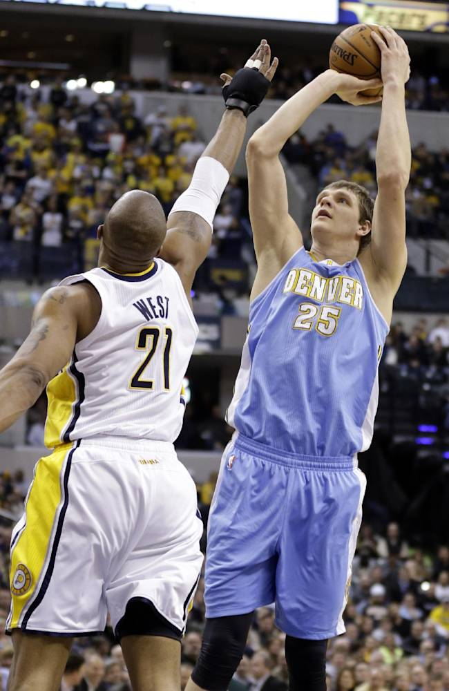 Denver Nuggets center Timofey Mozgov (25) shoots over Indiana Pacers forward David West in the first half of an NBA basketball game in Indianapolis, Monday, Feb. 10, 2014