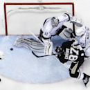 Los Angeles Kings goalie Martin Jones (31) blocks a shot by Pittsburgh Penguins' Sidney Crosby (87) with help from Alec Martinez (27) during the third period of an NHL hockey game in Pittsburgh, Thursday, Oct. 30, 2014. Penguins' Chris Kunitz collected th