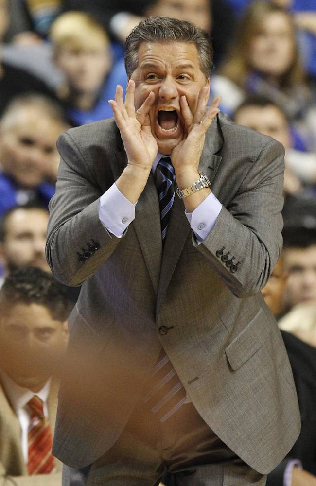 Kentucky head coach John Calipari shouts to his team during the first half of an NCAA college basketball game against Eastern Michigan, Wednesday, Nov. 27, 2013, in Lexington, Ky