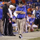 FILE- In this Oct. 18, 2014, file photo, Florida head coach Will Muschamp paces the sidelines during the second half of an NCAA college football game against Missouri in Gainesville, Fla. With his job on the line, Muschamp is turning to freshman quarterba