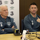 Republic of Ireland captain Robbie Keane, right, and manager Giovanni Trapattoni speak to the press during a news conference in Jersey City, N.J., Monday, June 10, 2013. Ireland will play the reigning World Cup champion Spain at Yankee Stadium on June 11, 2013. (AP Photo/Seth Wenig)