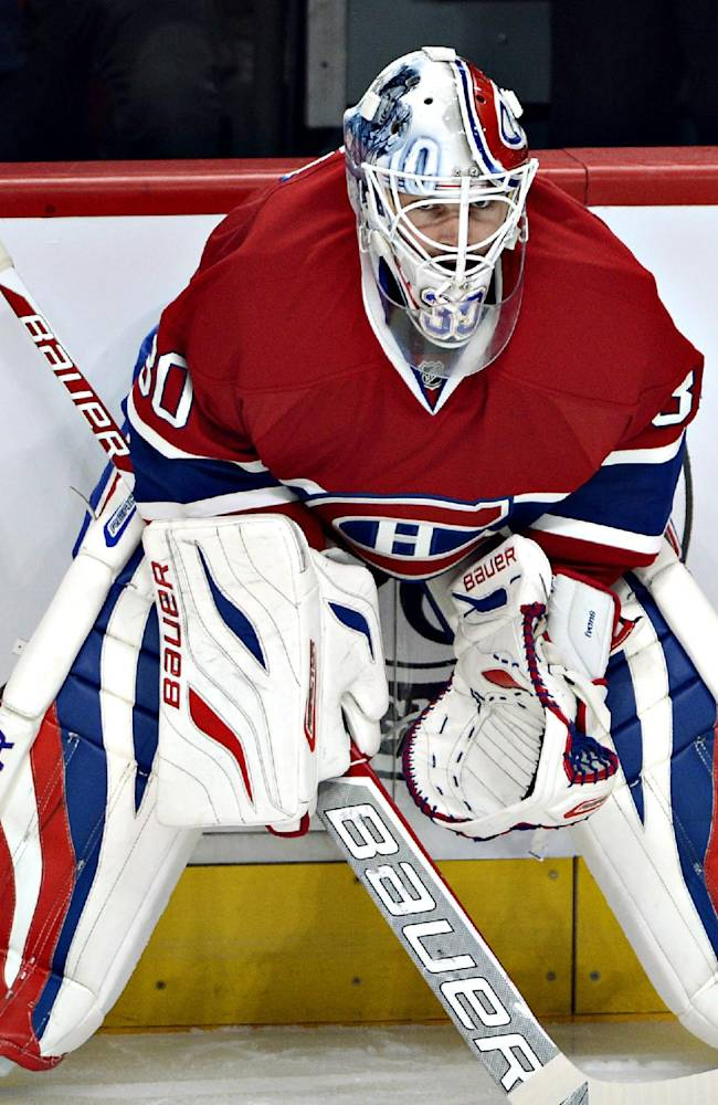 CORRECTS SPELLING OF PETER BUDAJ'S LAST NAME- Montreal Canadiens goalie Peter Budaj warms up before the season opener against the Toronto Maple Leafs in an NHL hockey game on Tuesday, October 1, 2013, in Montreal
