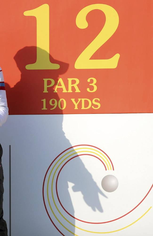 China's Guan Tianlang pauses while playing in the first day of the Asia-Pacific Amateur Championship golf tournament at Nanshan International Golf Club in Longkou city in east China's Shandong province on Thursday, Oct. 24, 2013. (AP Photo)