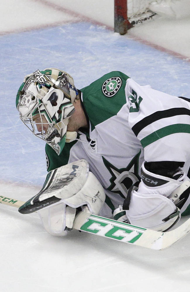 Dallas Stars goalie Kari Lehtonen, of Finland, looks at the puck after Anaheim Ducks' Andrew Cogliano scored against him during the third period in Game 2 of the first-round NHL hockey Stanley Cup playoff series on Friday, April 18, 2014, in Anaheim, Calif. The Ducks won 3-2