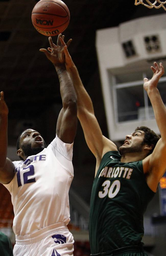 Kansas State guard Omari Lawrence, left, battles for a rebound against Charlotte's Marcus Bryan during a NCAA college basketball game in San Juan, Puerto Rico, Thursday, Nov. 21, 2013