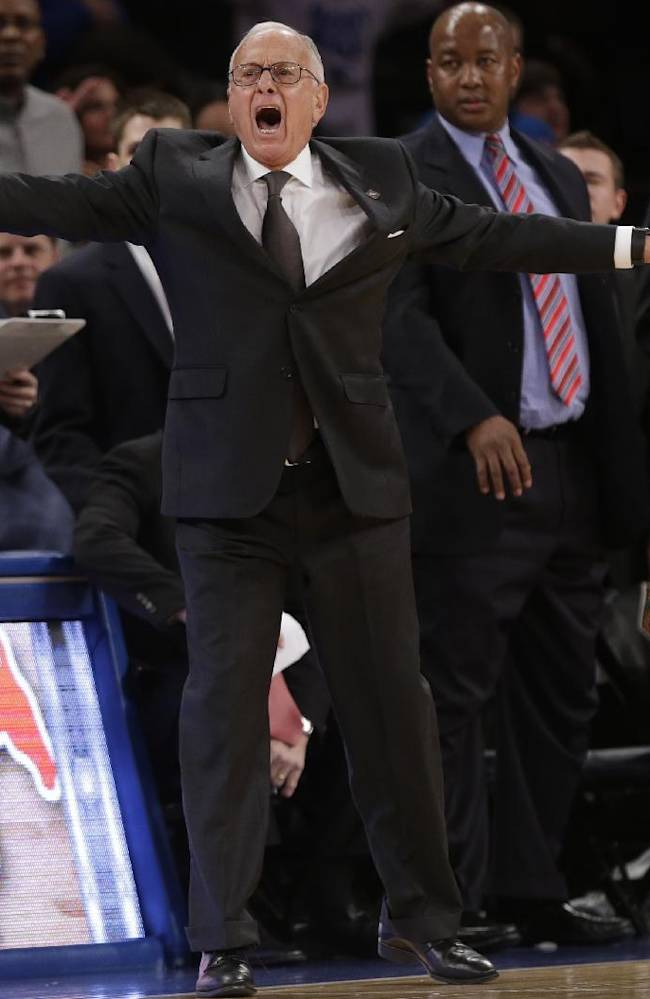 SMU head coach Larry Brown calls out to his team during the second half of an NCAA college basketball game against Clemson in the semifinals of the NIT Tuesday, April 1, 2014, in New York. SMU won the game 65-59