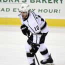 Los Angeles Kings' Mike Richards looks to pass the puck during the third period of an NHL hockey game against the New Jersey Devils, Monday, March 23, 2015, in Newark, N.J. The Kings won 3-1. (AP Photo/Bill Kostroun)
