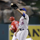 New York Mets starting pitcher Dillon Gee (35) catches a throw as Los Angeles Angels' Mike Trout, background left, rounds the bases after hitting a home run during the first inning of a baseball game on Friday, April 11, 2014, in Anaheim, Calif The Associ