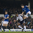 Everton's Gareth Barry, right, fights for the ball against West Bromwich Albion's Andre Wisdom, second right, during the English Premier League soccer match between Everton and West Bromwich Albion at Goodison Park Stadium, Liverpool, England, Monday Jan.