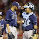 Tampa Bay Rays starting pitcher David Price, left, talks with catcher Jose Molina after Price gave up a solo home run to Cincinnati Reds' Joey Votto in the ninth inning of a baseball game, Friday, April 11, 2014, in Cincinnati. Price was the winning pitch