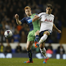 Newcastle United's Jack Colback, left, challenges Tottenham's Benjamin Stambouli for the ball during their English League Cup soccer quarterfinal match between Tottenham Hotspur and Newcastle United at White Hart Lane stadium in London, Wednesday, Dec. 17