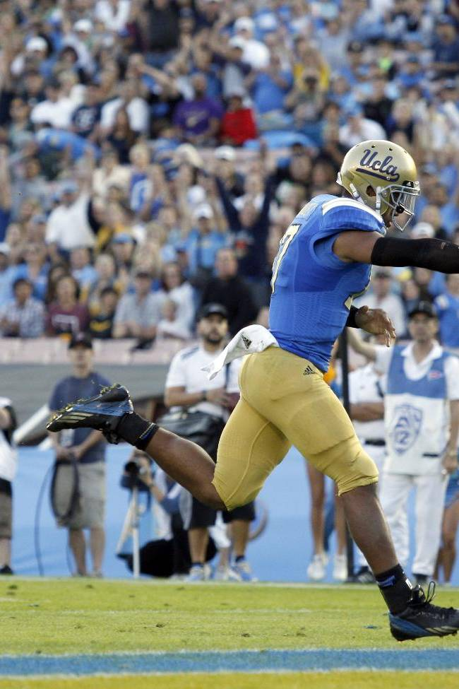 UCLA quarterback Brett Hundley runs for a touchdown uncontested in the first half of their NCAA college football game against Colorado, Saturday, Nov. 2, 2013, in Pasadena, Calif