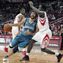 Minnesota Timberwolves' Ricky Rubio (9) looks to the basket between Houston Rockets Terrence Jones (6) and Patrick Beverley in the first half of an NBA basketball game Saturday, Nov. 23, 2013, in Houston The Associated Press