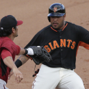 Arizona Diamondbacks third baseman Eric Chavez, left, tags out San Francisco Giants' Hector Sanchez during the fifth inning of a spring training baseball game Sunday, March 2, 2014, in Scottsdale, Ariz The Associated Press