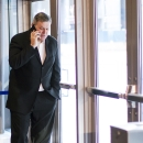 Outgoing Maple Leafs Sports and Entertainment President and CEO Tim Leiweke talks on the phone as the Major League Soccer team Toronto FC introduces Jozy Altidore as the teams latest signing in Toronto on Friday, Jan. 16, 2015 The Associated Press