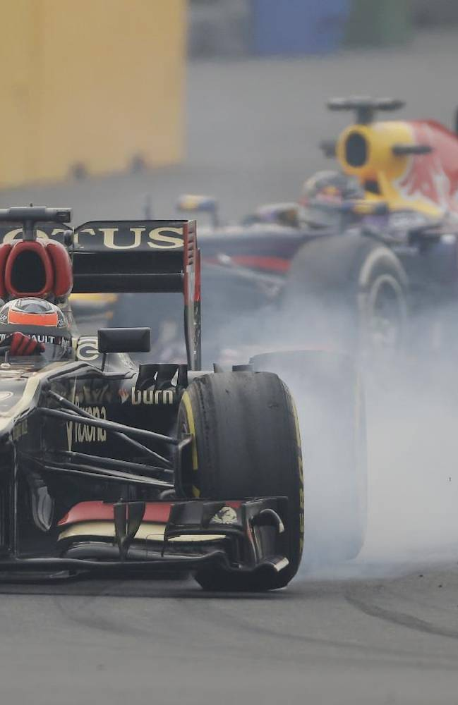 Lotus driver Kimi Raikkonen of Finland locks up his brakes during the second practice session at the Indian Formula One Grand Prix at the Buddh International Circuit in Noida, India, Friday, Oct. 25, 2013