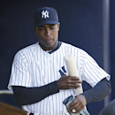 New York Yankees left fielder Alfonso Soriano walks through the dugout before an exhibition baseball game against the Philadelphia Phillies Saturday, March 1, 2014, in Tampa, Fla The Associated Press