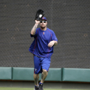 Texas Rangers left fielder Josh Hamilton catches a fly ball while working out before a baseball game against the Oakland Athletics in Arlington, Texas, Tuesday, June 23, 2015. (AP Photo/LM Otero)