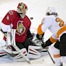 Philadelphia Flyers center Claude Giroux, right, deflects a shot wide of the net past Ottawa Senators goalie Craig Anderson during the second period of an NHL hockey game Tuesday, Nov. 12, 2013, in Ottawa, Ontario The Associated Press