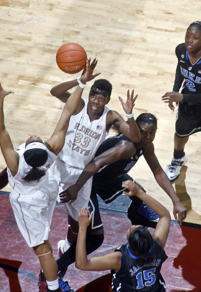Florida State forward Natasha Howard (33) eyes a rebound as Duke center/forward Elizabeth Williams (1) tries to box her out in the first half of an NCAA college basketball game, Thursday, Jan. 23, 2014, in Tallahassee, Fla