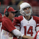 In this Dec. 11, 2014, file photo, Arizona Cardinals head coach Bruce Arians talks with quarterback Ryan Lindley (14) during the second half of an NFL football game against the St. Louis Rams in St. Louis. Arians cut quarterback Ryan Lindley at the end o