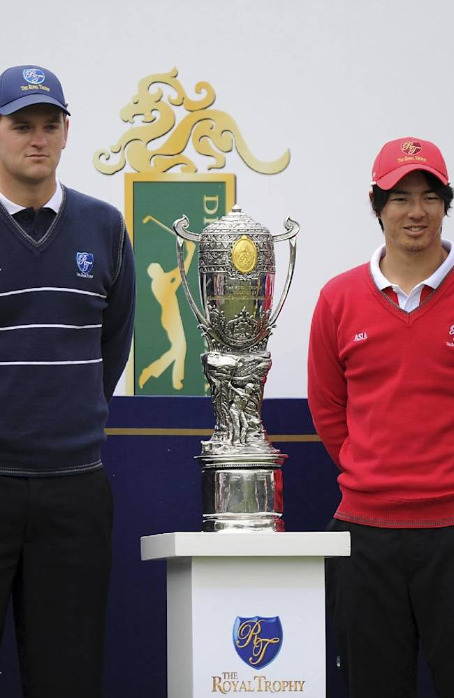 Golfers, from left to right, Nicolas Colsaerts of Belgium, Bernd Wiesberger of Austria, Ryo Ishikawa and Hiroyuki Fujita of Japan pose with the trophy before their Foursomes Match at the 7th Edition of the Royal Trophy-Europe vs Asia Golf Championship in the Guangzhou Dragon Lake Golf Club in Guangzhou in south China's Guangdong province on Friday, Dec. 20, 2013