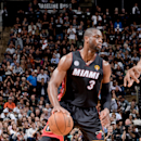 SAN ANTONIO, TX - JUNE 13: Dwyane Wade #3 of the Miami Heat controls the ball against Kawhi Leonard #2 of the San Antonio Spurs during Game Four of the 2013 NBA Finals on June 13, 2013 at AT&T Center in San Antonio, Texas. (Photo by D. Clarke Evans/NBAE via Getty Images)