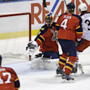 Florida Panthers goalie Roberto Luongo, left, defenseman Dylan Olsen (4) and Columbus Blue Jackets center Boone Jenner (38) watch the puck go into the net on a goal scored by Columbus Blue Jackets center Mark Letestu in the second period of a hockey game,