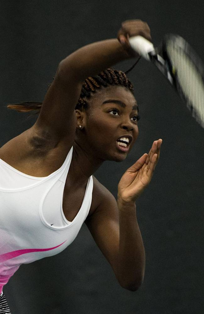 Tennis Canada member Francoise Abanda serves to Czech native Tomas Plekanec of the Montreal Canadiens as they play a friendly tennis match Friday, Jan. 30, 2015 in Montreal. The match was to promote the upcoming women's tennis Fed Cup tie against the Czech Republic. Abanda won 10-6